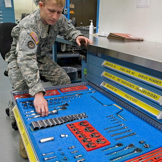 Military man opening a drawer of a cabinet