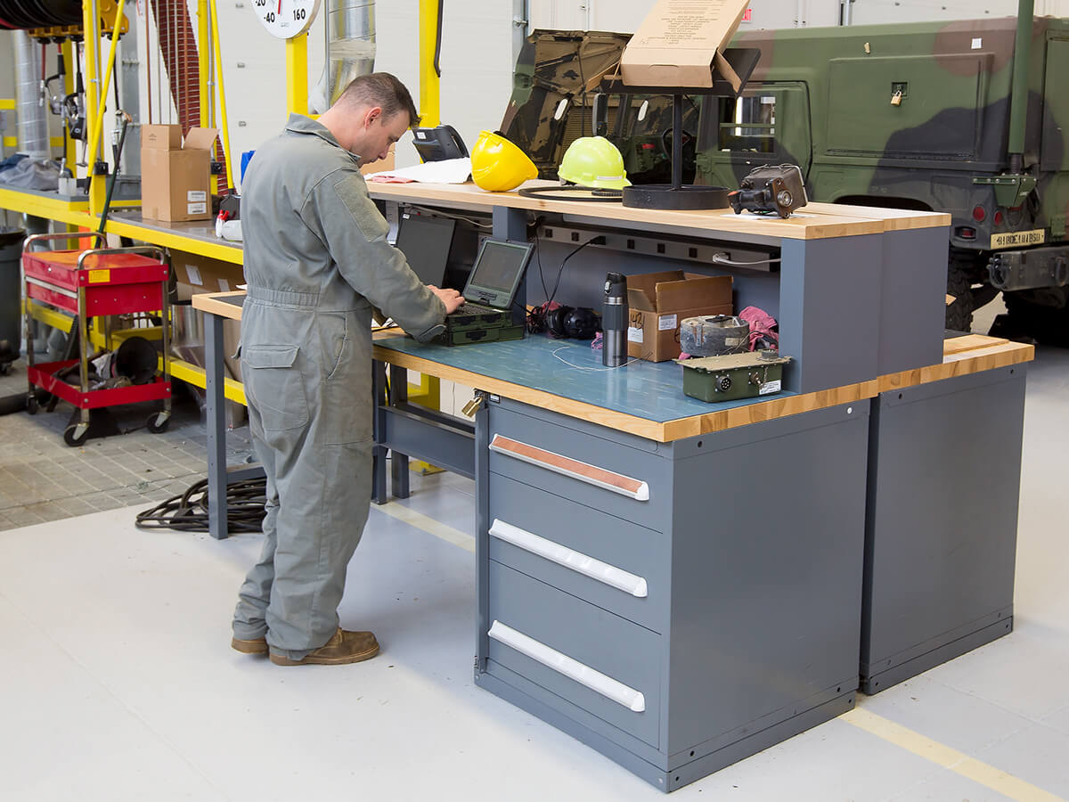 Military man using an Industrial workstation